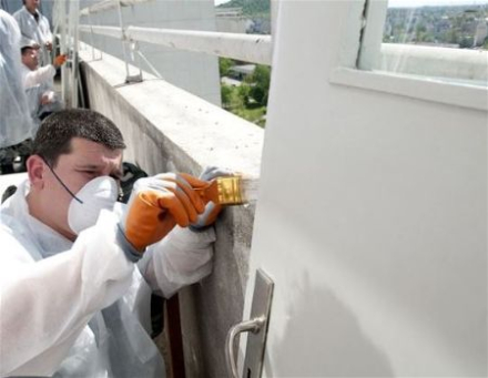 Painting the roof of a medical building Henderson Nevada